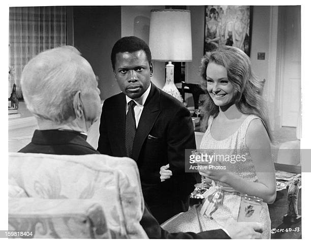 Sidney Poitier and Katharine Houghton between scene enjoying their company from the film 'Guess Who's Coming to Dinner' 1967
