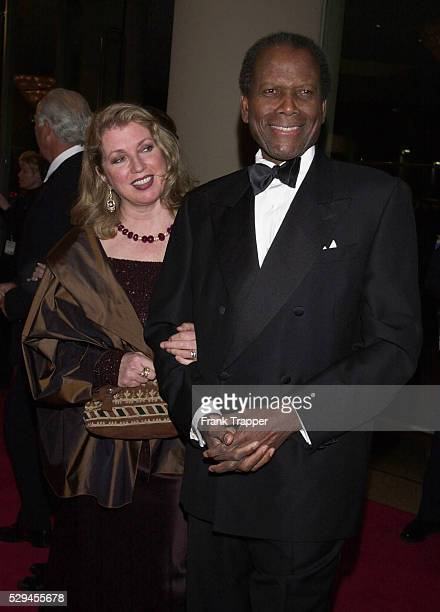 Sidney Poitier and wife Joanna Shimkus arrive at the American Film Institute Life Achievement Award for Barbara Streisand.