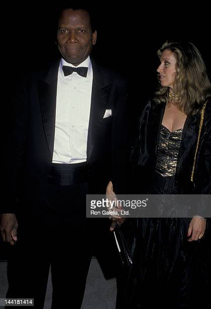 Sidney Poitier and wife Joanna Shimkus attend Georgio Armani SpringSummer Fashion Show on January 27 1988 at the Museum of Contemporary Art in Los...