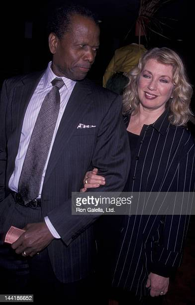 Sidney Poitier and wife Joanna Shimkus attend the premiere of Crasy As Hell on February 6 2002 at Loew's Cineplex Odeon Cinema in Century City...