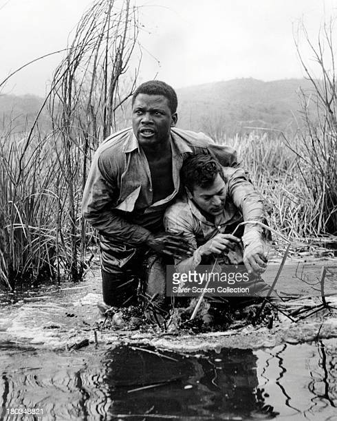 Sidney Poitier as Noah Cullen and Tony Curtis as John 'Joker' Jackson in 'The Defiant Ones' directed by Stanley Kramer 1958