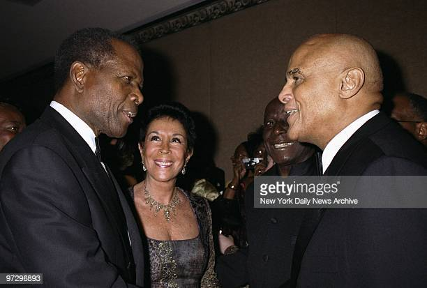 Sidney Poitier chats with Harry Belafonte and his wife Julie at a University of the West Indies gala honoring Poitier at the Marriott Marquis Hotel