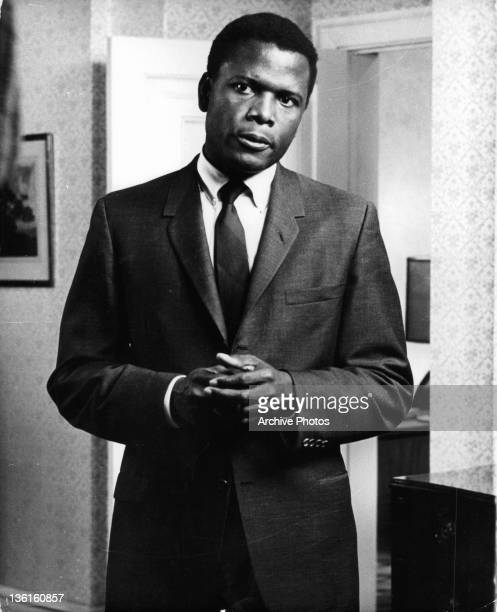 Sidney Poitier standing with his hands folded in a scene from the film 'In The Heat Of The Night' 1967