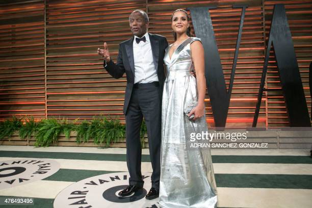 Sidney Poitier, with his daughter, Sydney Poitier, arrives to the 2014 Vanity Fair Oscar Party on March 2, 2014 in West Hollywood, California. AFP...