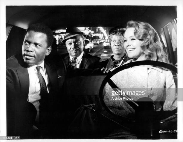 Sidney Poitier with parents Roy E Glenn and Beah Richards while Katherine Houghton drives in a scene from the film 'Guess Who's Coming To Dinner' 1967