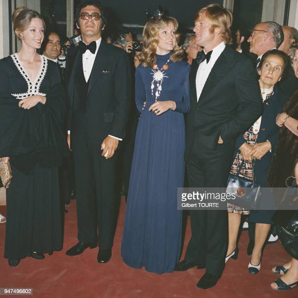 Sidney Pollack and Robert Redford with his wife Lola Van Wagenen