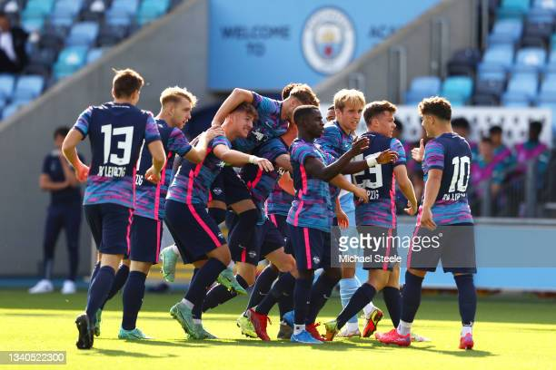 Sidney Raebiger of RB Leipzig celebrates with team mates after scoring their side's first goal during the UEFA Youth League match between Manchester...