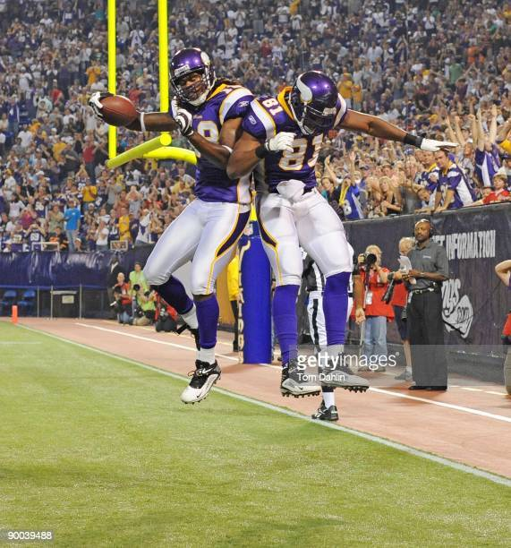 Sidney Rice and Visanthe Shiancoe of the Minnesota Vikings celebrate a touchdown by Rice during an NFL game against the Kansas City Chiefs at the...