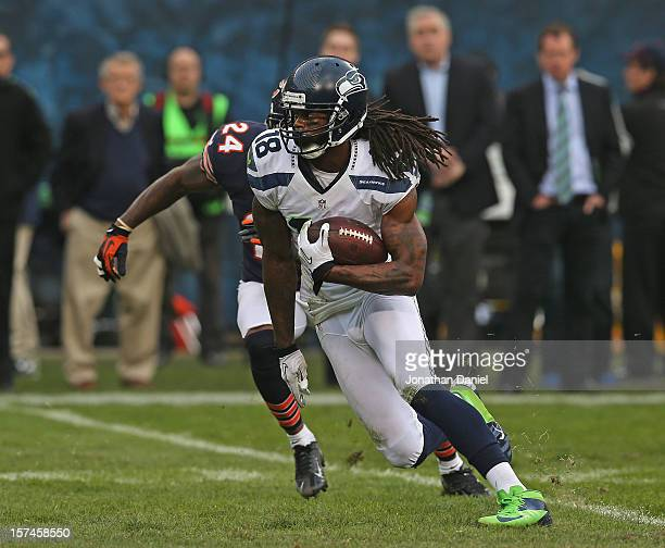 Sidney Rice of the Seattle Seahawks breaks up the field past Kelvin Hayden of the Chicago Bears at Soldier Field on December 2 2012 in Chicago...