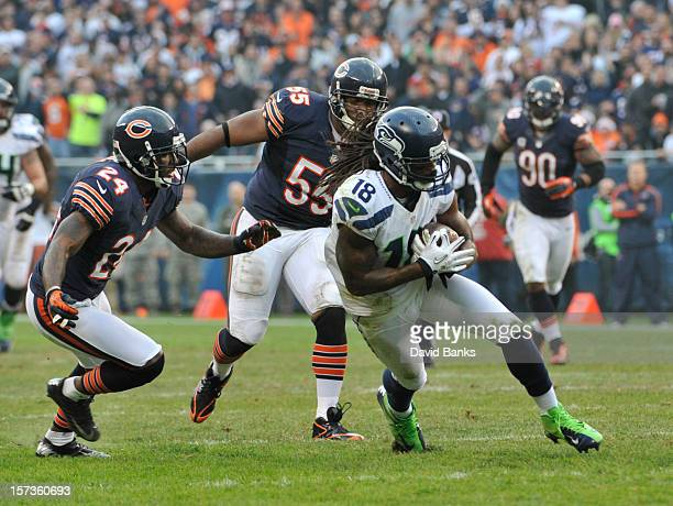 Sidney Rice of the Seattle Seahawks is chased down by Kelvin Hayden of the Chicago Bears on December 2 2012 at Soldier Field in Chicago IllinoisThe...