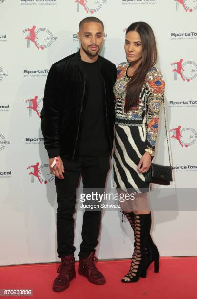 Sidney Sam and his wife Joyce pose at the 10th anniversary celebration of the Sports Total Agency on November 5 2017 in Cologne Germany