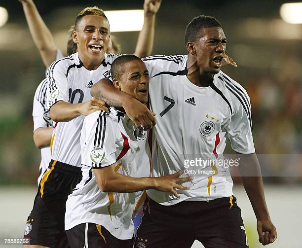 Sidney Sam celebrates his goal with team mates during the UEFA U19 European Championship match between Germany and Serbia at the Waldstadion on July...