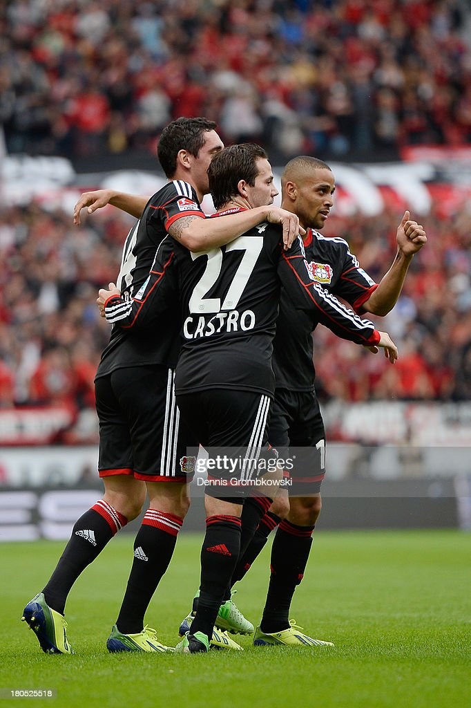 Sidney Sam of Bayer Leverkusen celebrates with teammates after scoring his team's first goal during the Bundesliga match between Bayer 04 Leverkusen and VfL Wolfsburg at BayArena on September 14, 2013 in Leverkusen, Germany.