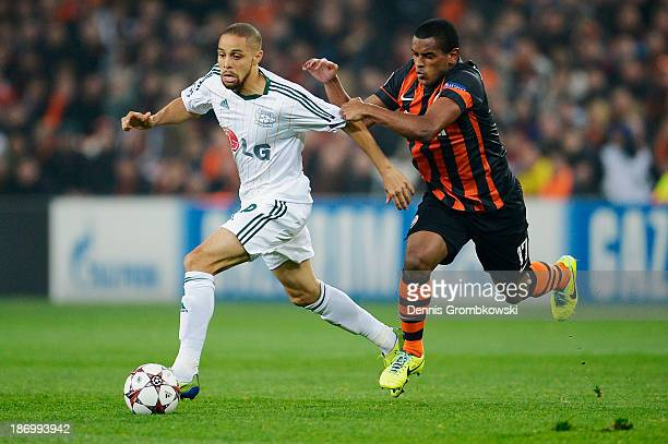 Sidney Sam of Bayer Leverkusen is chased by Fernando of Shakhtar Donetsk during the UEFA Champions League Group A match between Shakhtar Donetsk and...