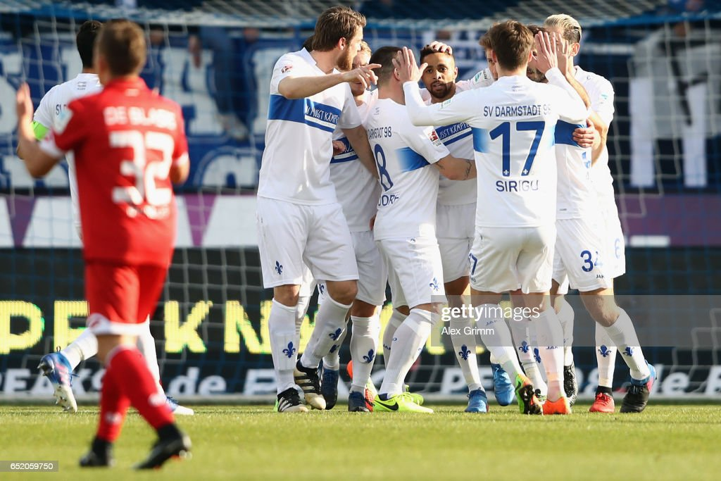 Sidney Sam (C) of Darmstadt celebrates his team's second goal with team mates during the Bundesliga match between SV Darmstadt 98 and 1. FSV Mainz 05 at Jonathan-Heimes-Stadion am Boellenfalltor on March 11, 2017 in Darmstadt, Germany.