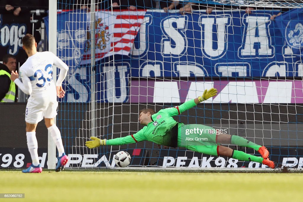 Sidney Sam of Darmstadt scores his team's second goal with a penalty against goalkeeper Jonas Loessl of Mainz during the Bundesliga match between SV Darmstadt 98 and 1. FSV Mainz 05 at Jonathan-Heimes-Stadion am Boellenfalltor on March 11, 2017 in Darmstadt, Germany.