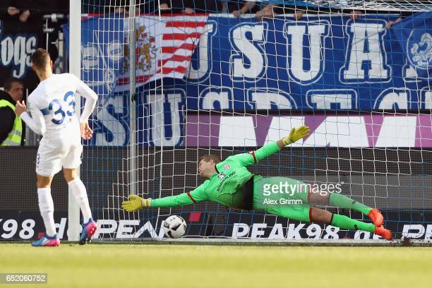 Sidney Sam of Darmstadt scores his team's second goal with a penalty against goalkeeper Jonas Loessl of Mainz during the Bundesliga match between SV...