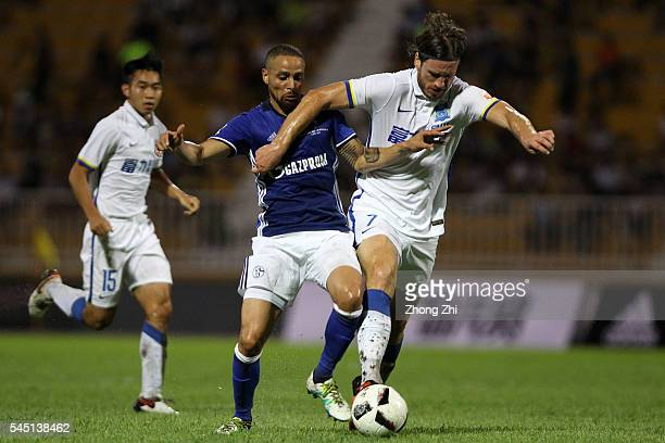 Sidney Sam of FC Schalke 04 in action against Svensson of Guangzhou RF during the ChinaGermany International Football Challenge match between FC...