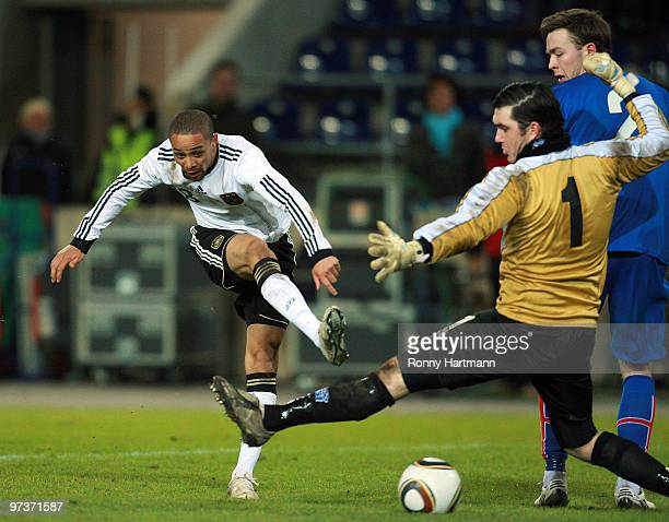 Sidney Sam of Germany vie for the ball with goalkeeper Haraldur Bjornsson of Iceland during the U21 Euro Qualifying match between Germany and Iceland...