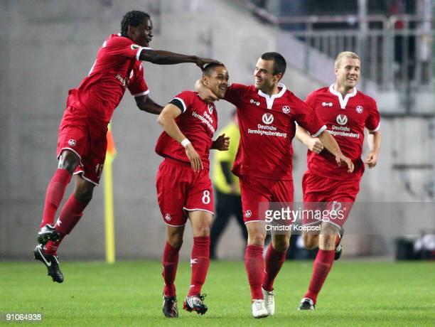 Sidney Sam of Kaiserslautern celebrates scoring his team's first goal with team mates Georges Mandjeck Bastian Schulz and Adam Nemec during the DFB...