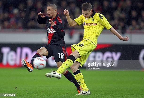Sidney Sam of Leverkusen challenges Sven Bender of Dortmund during the Bundesliga match between Bayer Leverkusen and Borussia Dortmund at BayArena on...