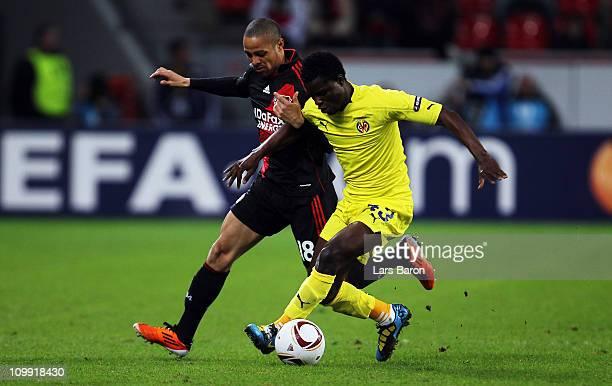 Sidney Sam of Leverkusen challenges Wakaso Mubarak of Villarreal during the UEFA Europa League round of 16 first leg match between Bayer Leverkusen...