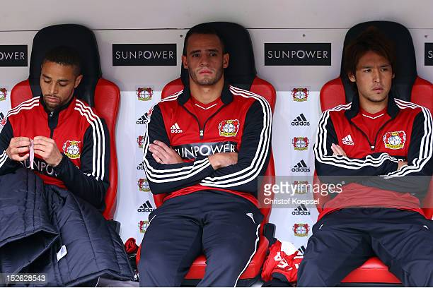 Sidney Sam Renato Augusto and Hajime Hosogai of Leverkusen sit on the bench during the Bundesliga match between Bayer 04 Leverkusen and Borussia...