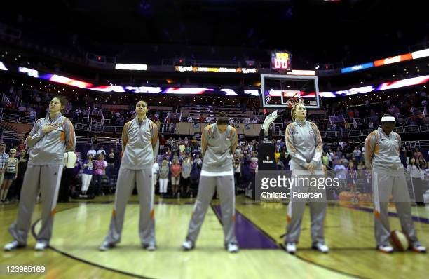 Sidney Spencer, Candice Dupree, Diana Taurasi, Penny Taylor and Marie Ferdinand-Harris of the Phoenix Mercury stand attended for the National Anthem...