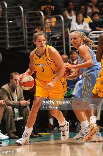 Sidney Spencer of the Los Angeles Sparks carries the ball during the game against Brooke Wyckoff of the Chicago Sky on June 18 2008 at Staples Center...