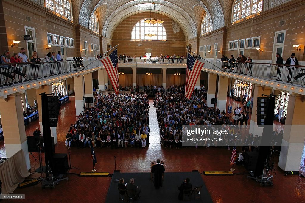 Sidney Stein Judge of the United States District Court for the Southern District of New York speaks during a special naturalization ceremony in honor of Citizenship Day and Constitution day Ellis Island in New York on September 16,2016. / AFP / KENA