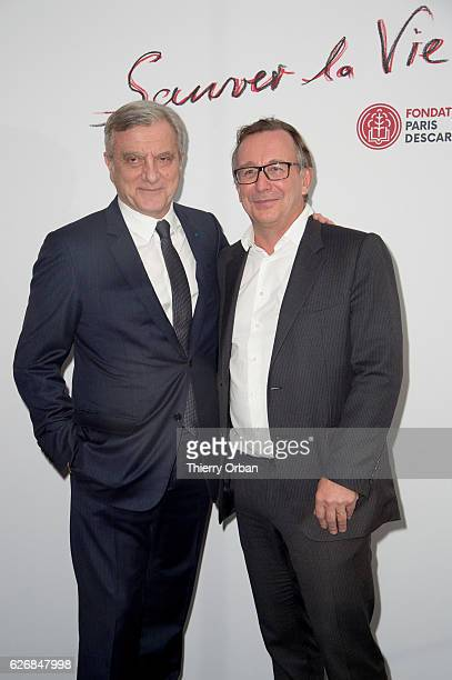 Sidney Toledano and Bruno Pavlovsky attend the diner 'sauver la vie' Eric Pfrunder Hosts 'Sauver La Vie' Diner for Paris Descartes Fondation at...