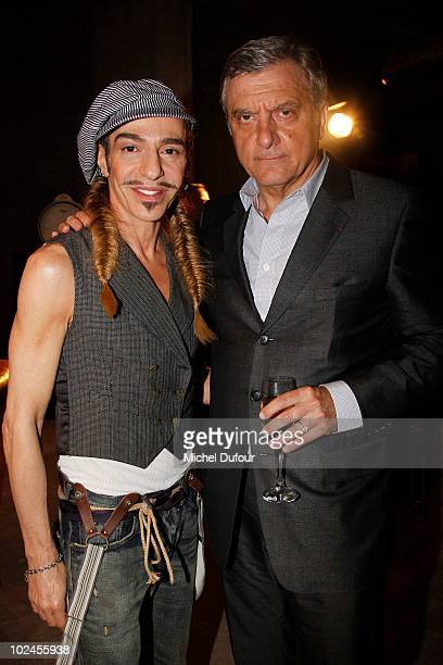 Sidney Toledano and John Galliano pose prior to the John Galliano show as part of Paris Menswear Fashion Week Spring/Summer 2011 on June 25, 2010 in...