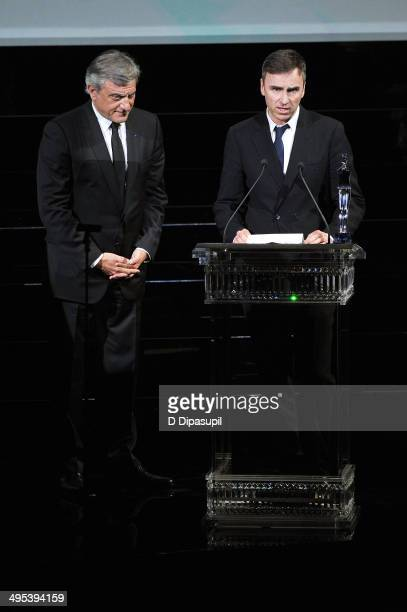 Sidney Toledano and Raf Simons speak onstage at the 2014 CFDA fashion awards at Alice Tully Hall, Lincoln Center on June 2, 2014 in New York City.