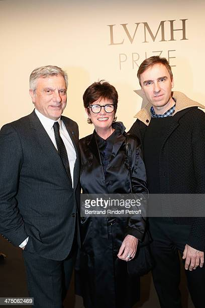 Sidney Toledano Dior CEO a guest and Raf Simons attend LVMH Prize SemiFinalists Designers Cocktail Party on February 26 2014 in Paris France