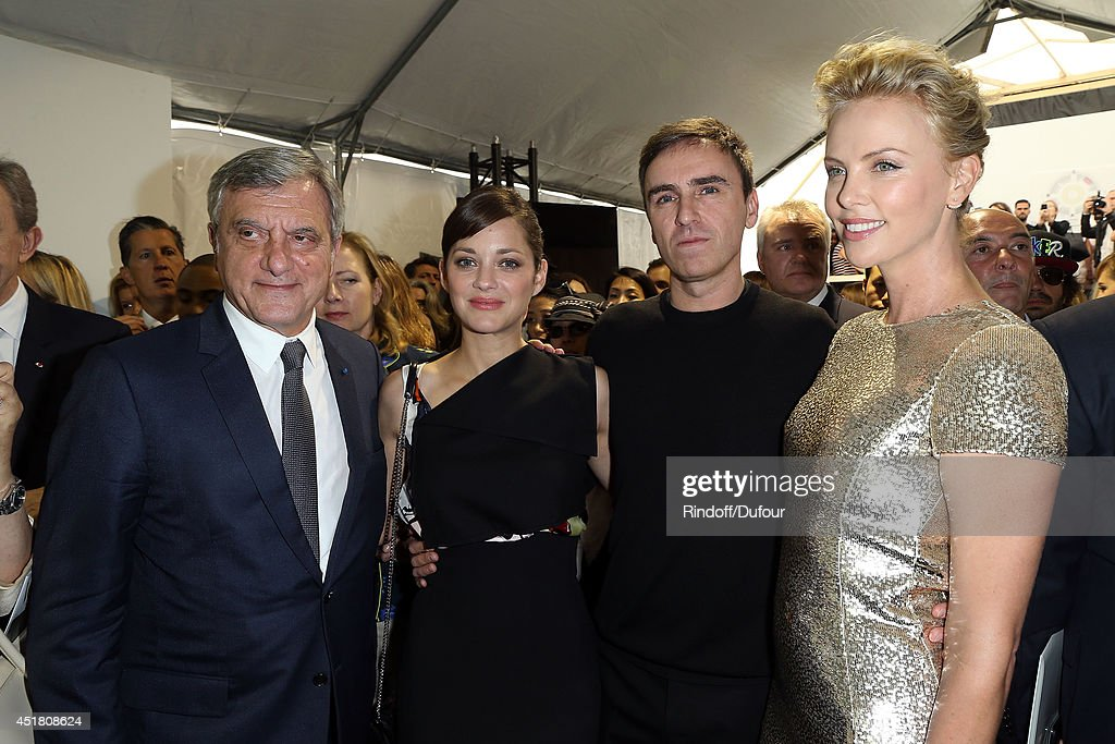 Sidney Toledano, Marion Cotillard, Raf Simons and Charlize Theron attend in backstage the Christian Dior show as part of Paris Fashion Week - Haute Couture Fall/Winter 2014-2015 at Muse Rodin on July 7, 2014 in Paris, France.