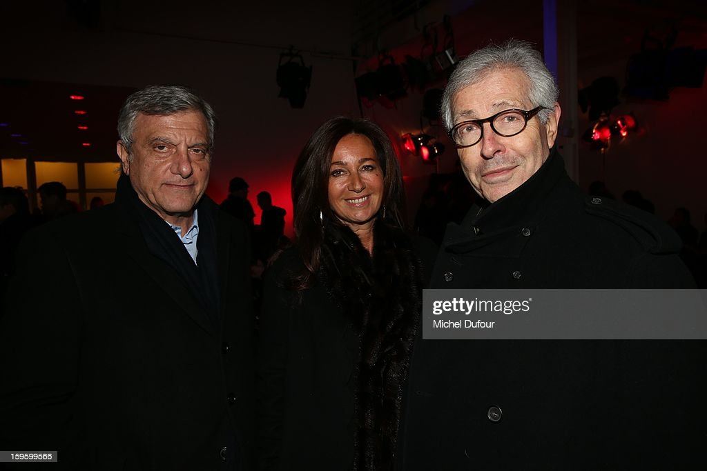 Sidney Toledano with his wife Katia and Didier Grumbach attend the Raf Simons Men Autumn / Winter 2013 show as part of Paris Fashion Week on January 16, 2013 in Paris, France.