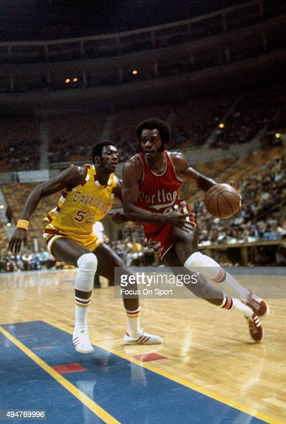 Sidney Wicks of the Portland Trail Blazers drives on Jim Brewer of the Cleveland Cavaliers during an NBA basketball game circa 1972 at the Cleveland...