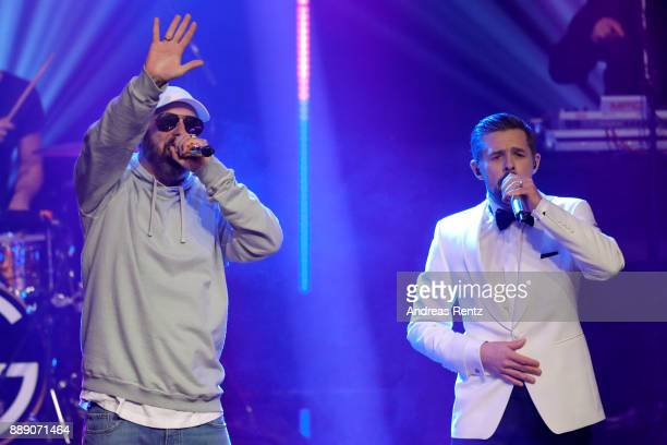 Sido and Klaas HeuferUmlauf perform on stage during the 1Live Krone radio award at Jahrhunderthalle on December 07 2017 in Bochum Germany