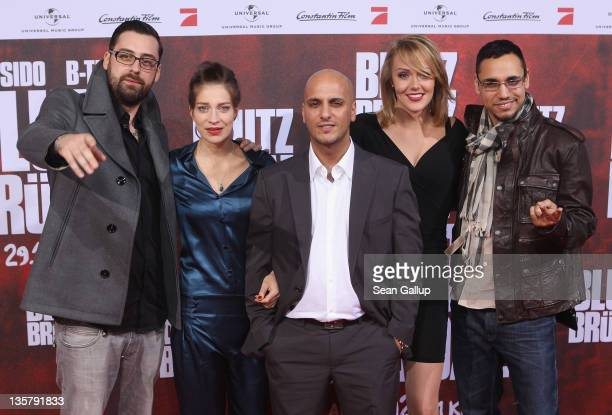 Sido Claudia Eisinger Alpa Gun Alwara Hoefels and BTight attend the 'Blutzbruedaz' premiere at CineStar Sony Center on December 14 2011 in Berlin...