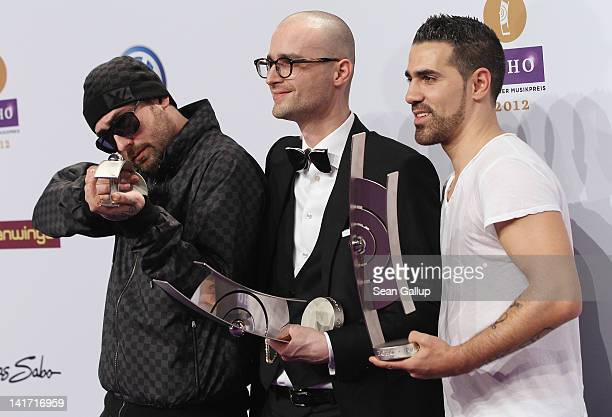 Sido Specter Berlin and Bushido pose with their Echo Music Awards for Best National Video at the Echo Award 2012 on March 22 2012 in Berlin Germany