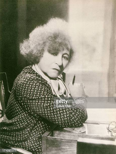 COLETTE Sidonie Gabrielle by Harcourt with pen in hand French literary figure of first half of 20th century Wrote the libretto for Ravel's 'L'enfant...