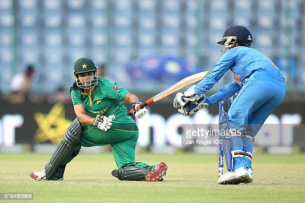 Sidra Ameen of Pakistan plays a sweep shot with Sushma Verma of India looking on during the Women's ICC World Twenty20 India 2016 match between India...