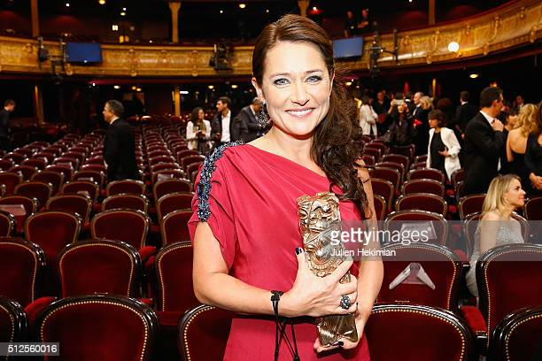 Sidse Babett Knudsen takes the pose after she received an award for the best actress in a supporting role in 'L'hermine' during The Cesar Film Award...