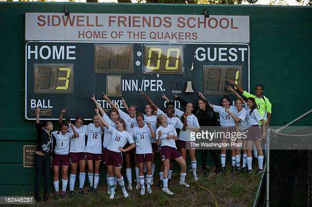 Sidwell girls soccer team celebrate their victory over NCS next to their scoreboard on Wednesday September 19th 2012 Sidwell wins 31