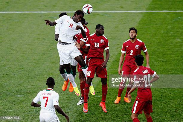 Sidy Sarr of Senegal and Almoez Ali of Qatar battle for the ball during the FIFA U20 World Cup New Zealand 2015 Group C match between Senegal and...
