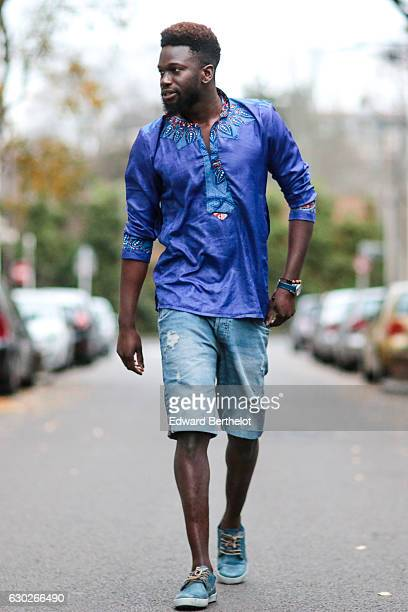 Sidya Sarr fashion and life style blogger is wearing Blackstone blue shoes a Bomberg watch a Zara light blue ripped short and a Dashiki blue tshirt...