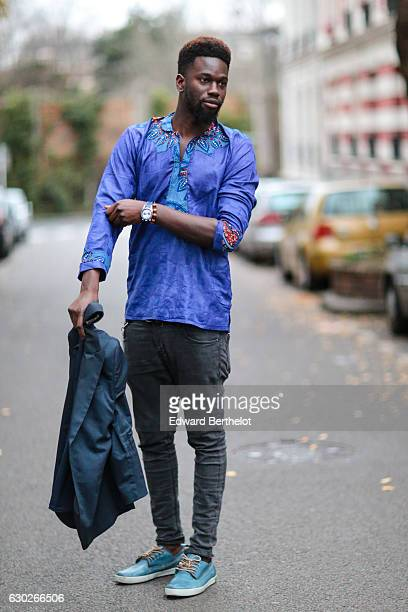 Sidya Sarr fashion and life style blogger is wearing Blackstone blue shoes a Bomberg watch Asos black pants and a Dashiki blue tshirt on December 19...