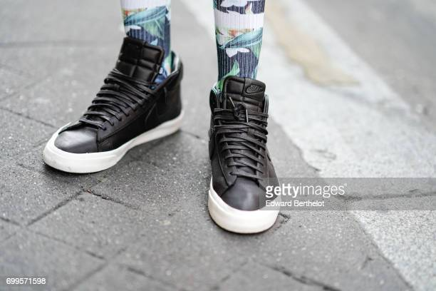 Sidya Sarr wears a Kiliwatch flower print tshirt an Asos hat Rayban sunglasses an Andreas Osten watch Asos jewelry a Zara short Stance socks and Nike...