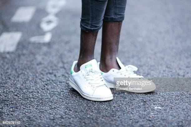 Sidya Sarr wears an Asos blue shirt Adidas Stan Smith white sneakers shoes Pull and Bear gray pants a Zara hat and a Cortese Torino watch on February...
