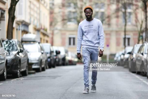 Sidya Sarr wears Puma gray shoes a Rad 'Draguer' sweater Zara denim jeans pants an Asos orange beanie hat and a Cortese Torino watch on January 31...